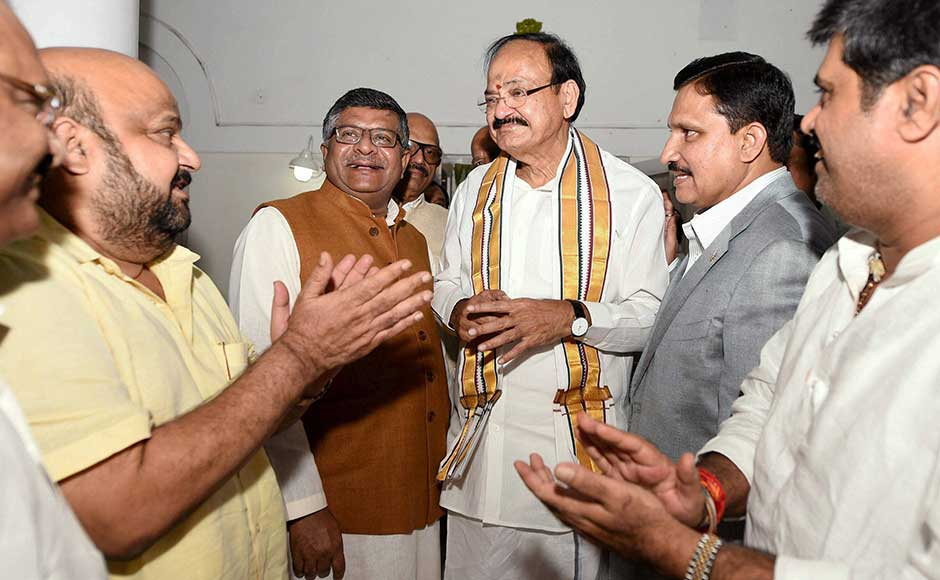 The two-time BJP president is pitted against Gopalkrishna Gandhi, who was chosen by an alliance of 18 Opposition parties, including the Congress. In this image, Naidu is greeted by Law Minister Ravi Shanker Prasad and MPs from Andhra Pradesh. PTI