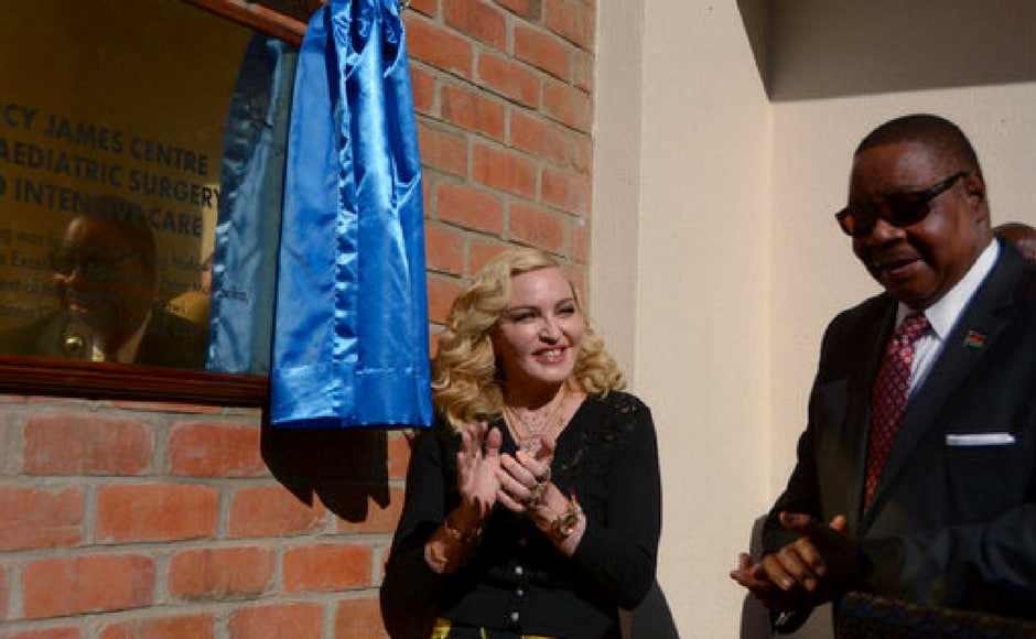 Madonna, left, and Malawian President Peter Mutharika, unveil a plaque at the opening of The Mercy James Institute for Pediatric Surgery and Intensive Care, at the Queen Elizabeth Central Hospital in the city of Blantyre, Malawi. (AP Photo)