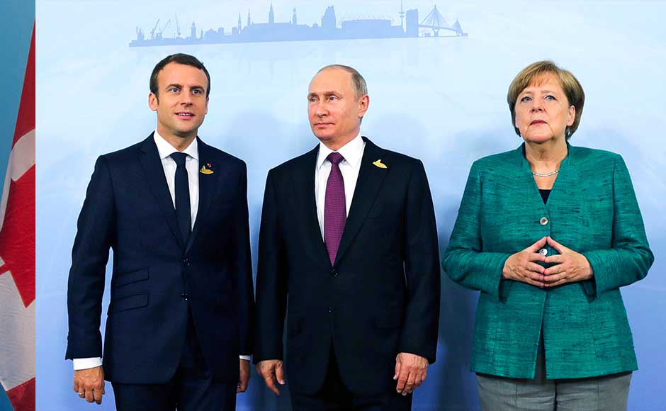 """Where there is no consensus, the communique spelt out the discord,"" said host Angela Merkel, who was praised by Russian President Vladimir Putin for finding an ""optimal compromise"" on the touchiest issue of climate. AP"