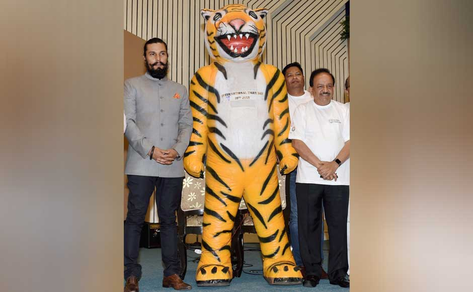 Union Minister of Environment, Forest and Climate Change, Harsh Vardhan and actor Randeep Hooda at celebrating Global Tiger Day in New Delhi. PTI