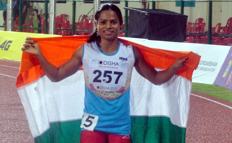 India's Dutee Chand celebrates after winning the bronze medal during the Women's 100m event. PTI
