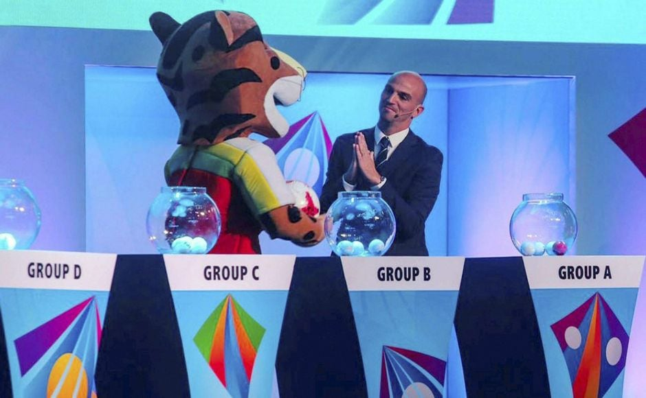 Argentine footballer Esteban Matías Cambiasso Deleau with the mascot 'Kheleo' of FIFA U-17 World Cup during the official draw of the FIFA Under-17 World Cup football tournament in Mumbai on Friday. PTI