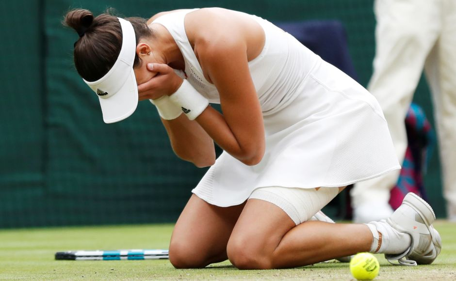 Muguruza fell to the floor in celebration after clinching victory in an hour and 17 minutes. Reuters