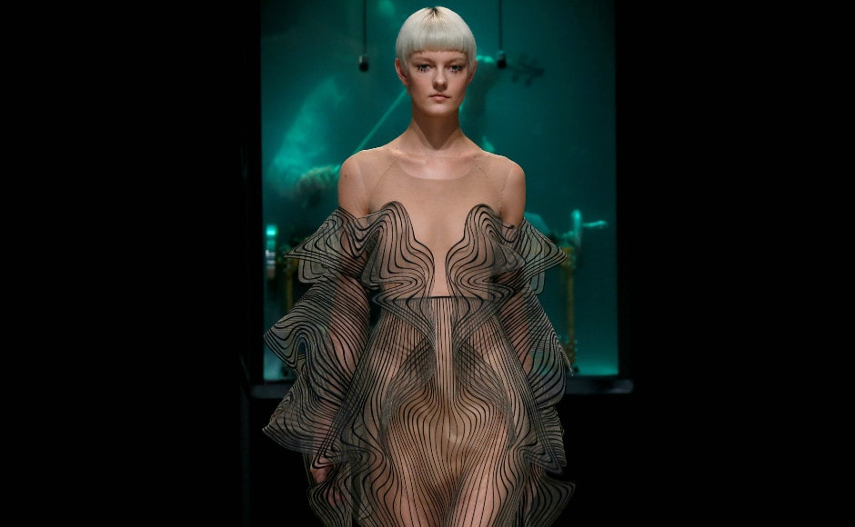 A model present a creation by designer Iris Van Herpen as part of her Haute Couture Fall/Winter 2017/2018 collection show in Paris. Image: Reuters