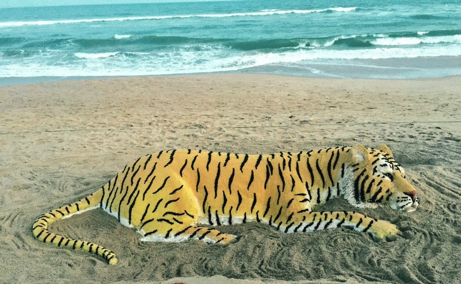 There are 13 Tiger Range Countries (TRC), including India, in the world where tigers roam free. Sand artist Sudarsan Patnaik created a sand sculpture urging citizens to protect the national animal of India. Image courtesy: Twitter/sudarsansand