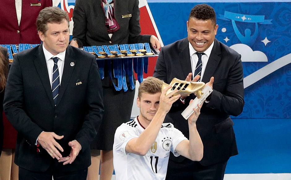 Germany's Timo Werner holds the Golden Boot of the competition as Brazilian footballer Ronaldo(R) looks on. AP