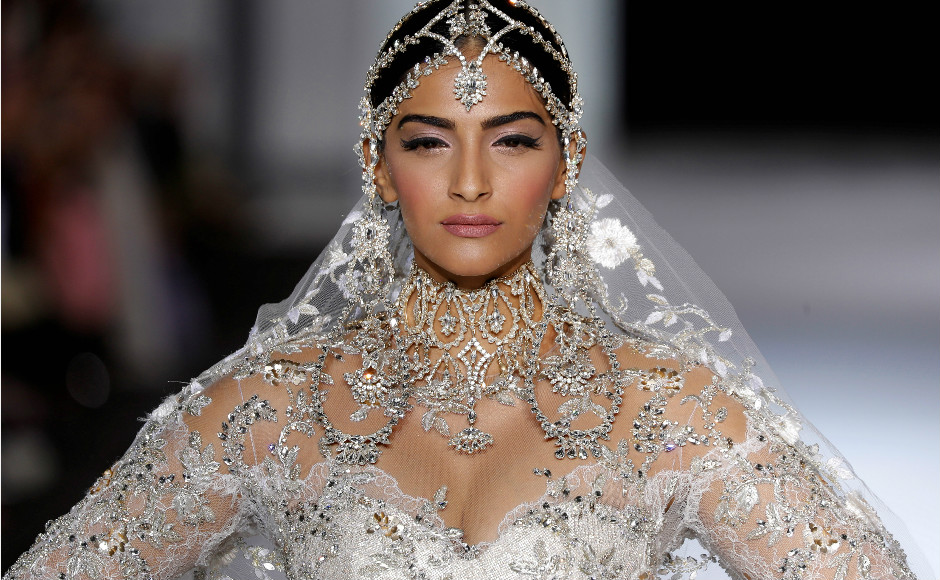 Sonam Kapoor presents a wedding dress by Australian designers Tamara Ralph and Michael Russo as part of their Haute Couture Fall/Winter 2017/2018 collection show for Ralph & Russo in Paris, France, 3 July 2017. Image: Reuters