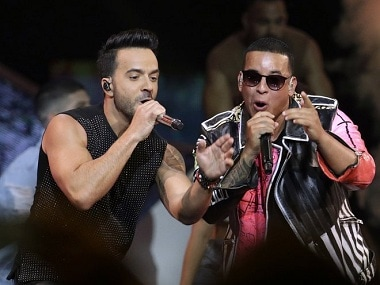 Puerto Rican singers Luis Fonsi and Daddy Yankee at a concert. Image from AP.