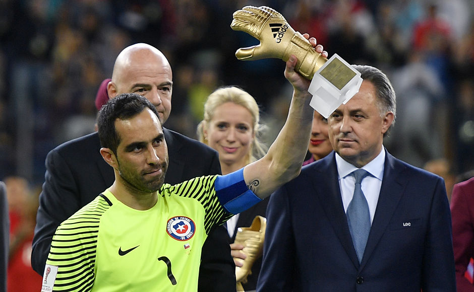 Chile goalkeeper Claudio Bravo holds the trophy as best goalkeeper in the Confederations Cup. AP