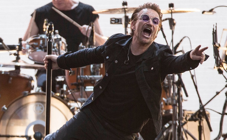 Bono performs on stage. Photo by AP