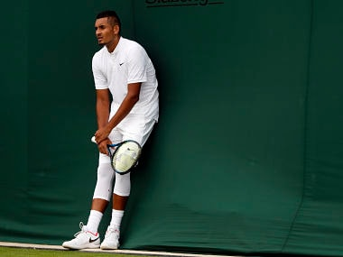 Nick Kyrgios rests during his Men's Singles Match against Pierre-Hugues Herbert. AP