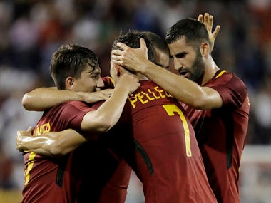 AS Roma's Marco Tumminello, back, is congratulated by teammates, from left, Cengiz Under, Lorenzo Pellegrini and Maxime Gonalons after scoring a goal against Tottenham during the second half of an International Champions Cup soccer game, Tuesday, July 25, 2017, in Harrison, N.J. Roma won 3-2. (AP Photo/Julio Cortez)