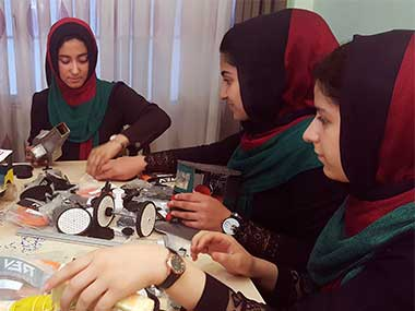 File image of the teenagers from the Afghanistan Robotic House, a private training institute, practice at the Better Idea Organization center, in Herat, Afghanistan. AP