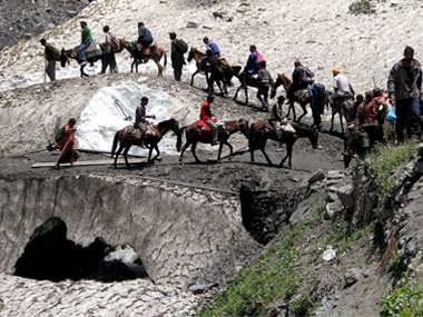 Pilgrims cross mountain trails during their religious journey to the Amarnath cave on the Baltal route, some 125 kms away from Srinagar. PTI