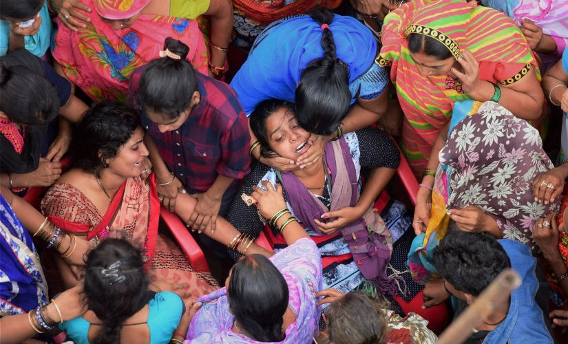 Family members of an Amarnath pilgrim, killed in Anantnag terror attack, mourn his death during his funeral in Dahanu, Maharashtra on Tuesday. PTI