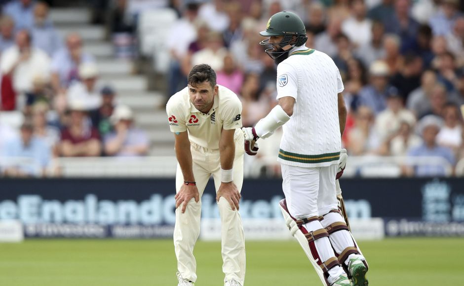 James Anderson with hands on his knees while Hashim Amla (R) jogged for a run signified England's position in the Test. AP