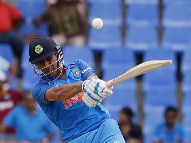 India's MS Dhoni plays a shot from the bowling of West Indies' captain Jason Holder during their third ODI cricket match at the Sir Vivian Richards Stadium in North Sound, Antigua and Barbuda, Friday, June 30, 2017. (AP Photo/Ricardo Mazalan)