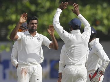 India's Ravichandran Ashwin, left, celebrates with teammates the dismissal of Sri Lanka's Niroshan Dickwella during the fourth day of their first test cricket match in Galle, Sri Lanka, Saturday, July 29, 2017. (AP Photo/Eranga Jayawardena)