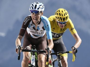 Romain Bardet (L) will look to outperform Christopher Froome in the International Time Trial. AFP