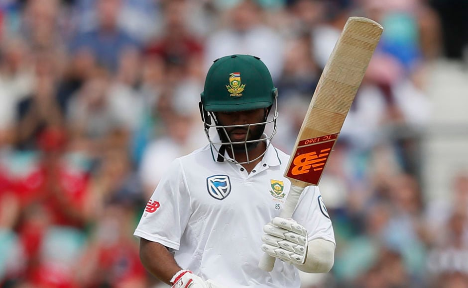 South Africa's Temba Bavuma celebrates getting 50 runs on the third day of the third test match between England and South Africa at The Oval cricket ground in London, Saturday, July 29, 2017. (AP Photo/Kirsty Wigglesworth)