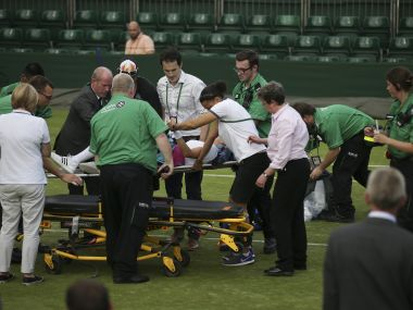 US player Bethanie Mattek-Sands is lifted onto a trolley on a stretcher by medics on court after suffering an injury during her women's singles second round match against Romania's Sorana Cirstea on the fourth day of the 2017 Wimbledon Championships at The All England Lawn Tennis Club in Wimbledon, southwest London, on July 6, 2017. America's Bethanie Mattek-Sands suffered a horror knee injury at Wimbledon on Thursday which left her screaming and crying in pain in the middle of the court. The 32-year-old collapsed to the ground after damaging her right knee as she approached the net in the first game of the deciding set against Romania's Sorana Cirstea on Court 17.  / AFP PHOTO / Daniel LEAL-OLIVAS / RESTRICTED TO EDITORIAL USE