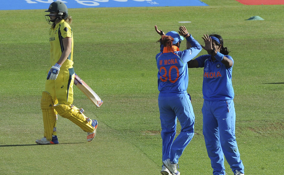 The middle order held on and looked to dent India's hopes of reaching the final. However, India's bowling and fielding pulled the team back into contention. India's Shikha Pandey, right, celebrates with India's Mona Meshram after dismissing Australia's Ellyse Perry. AP