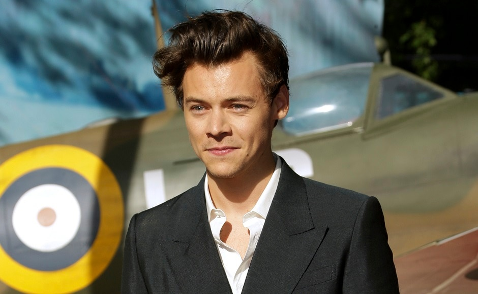 Harry Styles poses poses for photographers. Photo by AP
