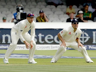 England's current captain Joe Root, left, and former captain Alastair Cook field in the slips together during the first test between England and South Africa at Lord's cricket ground in London, Saturday, July 8, 2017. (AP Photo/Matt Dunham)