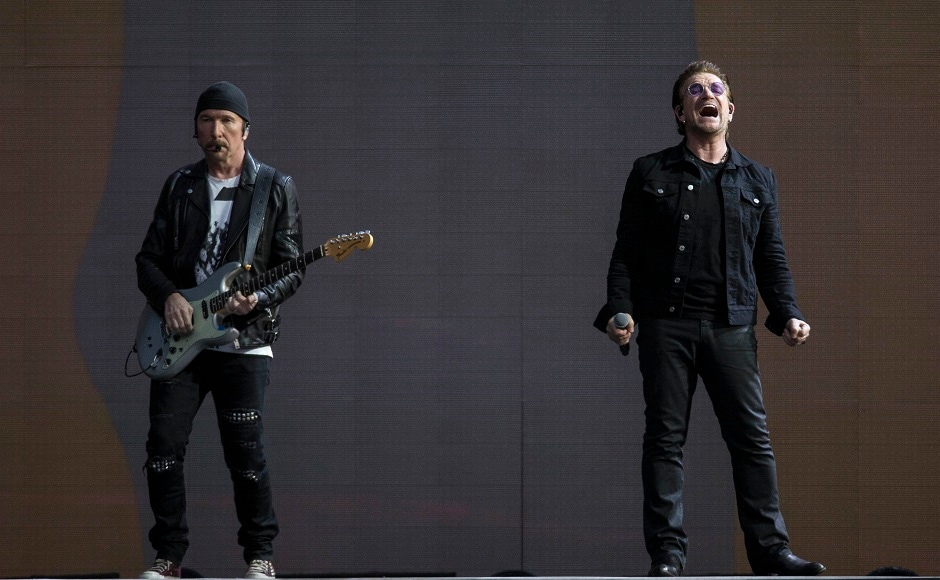 Singer Bono, right and The Edge, of the band U2 perform on stage. Photo by AP