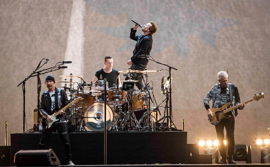 Members of U2 rock band, from left, The Edge, Larry Mullen Jr, Bono and Adam Clayton perform. Image via AP