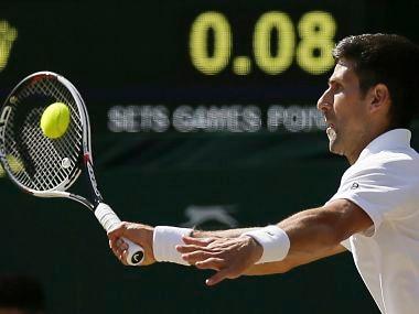 Serbia's Novak Djokovic returns to Latvia's Ernests Gulbis during their Men's Singles Match on day six at the Wimbledon Tennis Championships in London Saturday, July 8, 2017. (AP Photo/Tim Ireland)