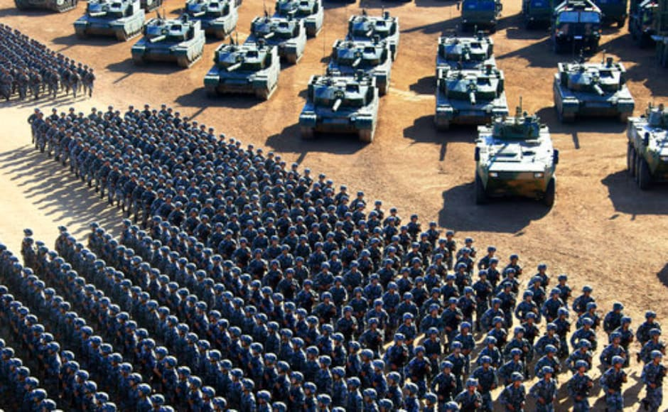 Chinese People's Liberation Army (PLA) troops march past military vehicles as they arrive for a military parade to commemorate the 90th anniversary of the founding of the PLA at Zhurihe training base in north China's Inner Mongolia Autonomous Region. AP