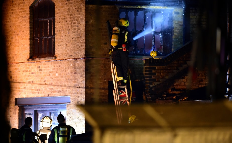 """The London Fire Brigade said on Twitter that the """"fire is now under control but crews will be damping down into the morning"""". Reuters"""