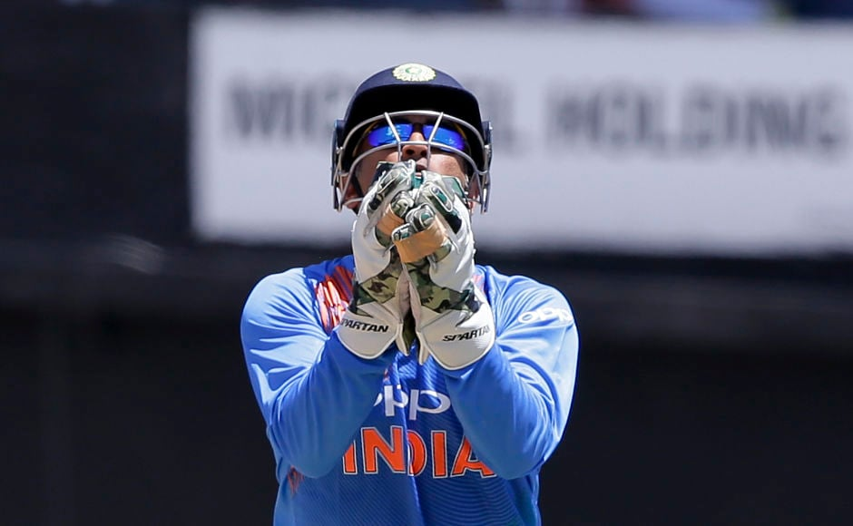 MS Dhoni pouches Chris Gayle's catch off Kuldeep Yadav's bowling but his wicket didn't change the game's situation at all. AP