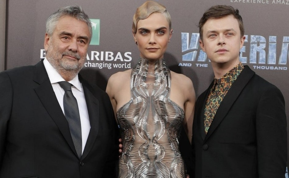 Director Luc Besson with his protagonists, Laureline and Valerian, at the premiere. Image from Getty Images.