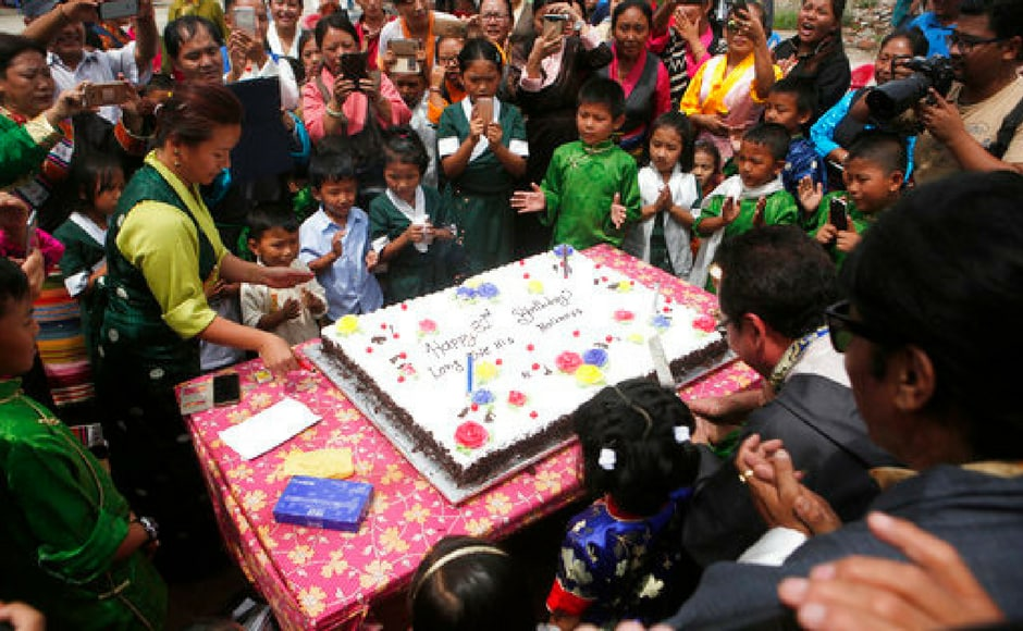 Tibetans gather to cut a cake in celebration of the 82nd birthday of their spiritual leader the Dalai Lama at a Tibetan camp in Lalitpur, Nepal on Tursday. AP