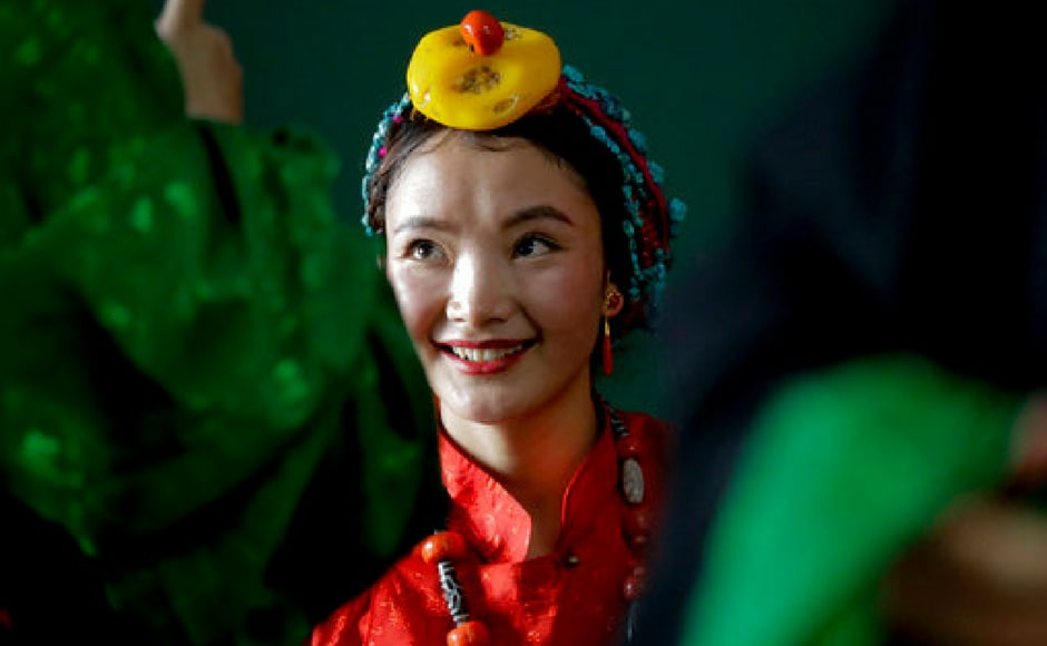 A dancer gears up for a performance in honour of the Dalai Lama in Nepal. AP