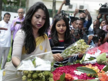 Bangladeshis pay their respects to victims on the first anniversary of the deadly hostage crisis at the upscale Holey Artisan Bakery in Dhaka. AP