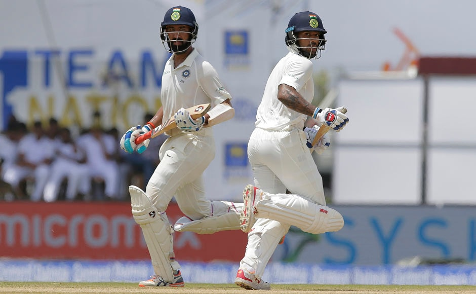 After Mukund's wicket, Shikhar Dhawan and Cheteshwar Pujara frustrated Sri Lanka and stitched a 253-run stand. AP