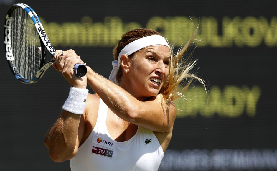Slovakia's eighth seed Dominika Cibulkova returns against American Jennifer Brady during her second round victory in Wimbledon. AFP