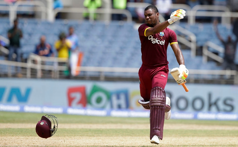 Windies' Evin Lewis celebrates after he slammed a 53-ball century. Both of his T20I centuries have come against India. AP