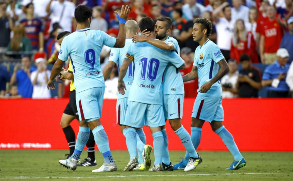 Barcelona players celebrate after Neymar scored a goal in the first half. AP