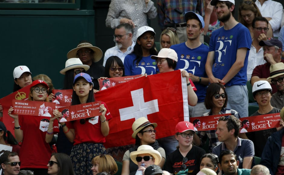 Fans of Roger Federer watch the Swiss ace's men's singles match against Ukraine's Alexandr Dolgopolov on day two at the Wimbledon Tennis Championships.<br />AP