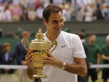 Switzerland's Roger Federer holds the trophy after defeating Croatia's Marin Cilic to win the Men's Singles final match on day thirteen at the Wimbledon Tennis Championships in London Sunday, July 16, 2017. (AP Photo/Alastair Grant)