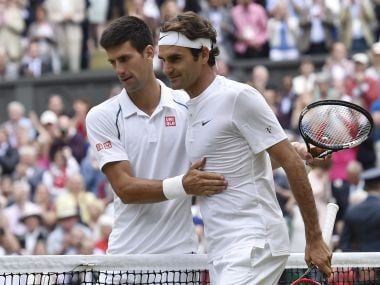 Novak Djokovic of Serbia embraces Roger Federer of Switzerland after winning their Men's Singles Final match at the Wimbledon Tennis Championships in London, July 12, 2015. REUTERS/Toby Melville - RTX1K3GL