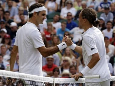 Switzerland's Roger Federer, left, shakes hands with Ukraine's Alexandr Dolgopolov after winning their Men's Singles Match on day two at the Wimbledon Tennis Championships in London Tuesday, July 4, 2017. (AP Photo/Alastair Grant)