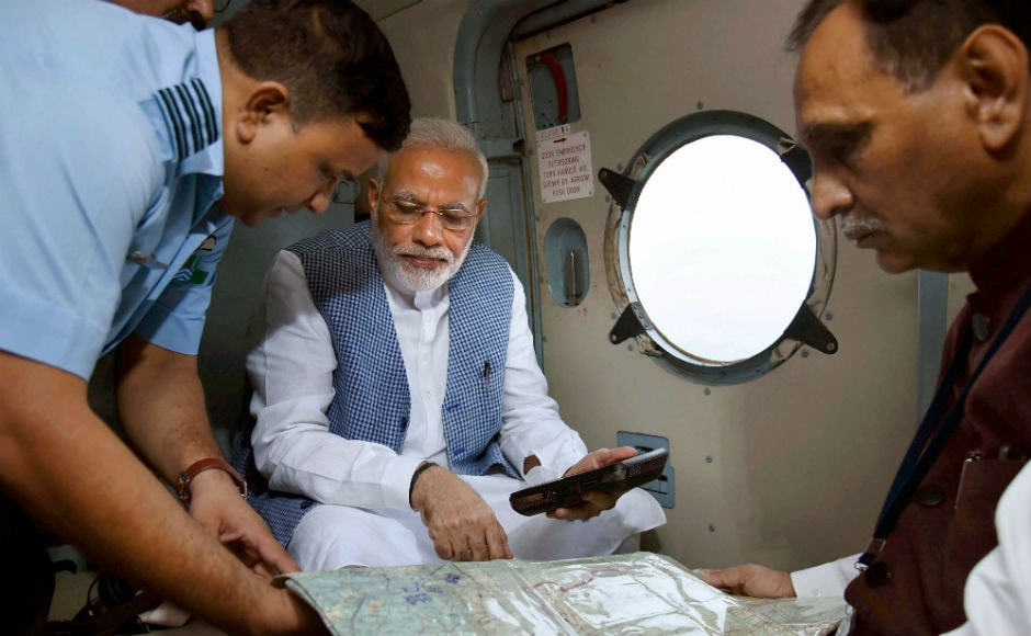 Narendra Modi carried out an aerial survey of the worst-hit Banaskantha and Patan districts in his home state of Gujarat. Over 83 people have been killed in the state with over 45,000 affected. PTI