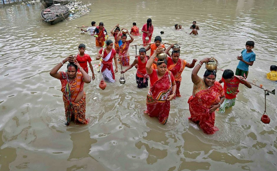 In Kolkata, devotees took a holy dip in the river Ganga before the start of their journey to Tarakeshwar Temple to offer puja. PTI