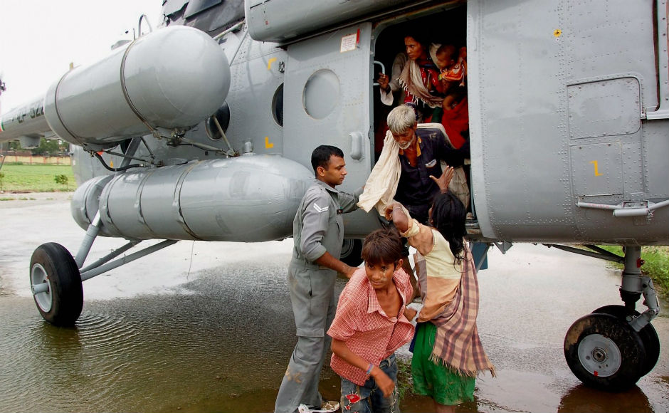 IAF's four MI-17 V5 helicopters winched 14 people from Deesa. A total of 113 people had been rescued by Tuesday. PTI