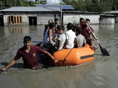 File image of locals stranded during the Assam floods. Reuters